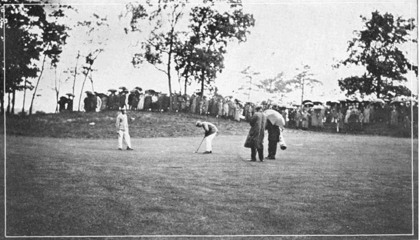 A photo Francis Ouimet putting on the 8th green during the 1913 US Open.