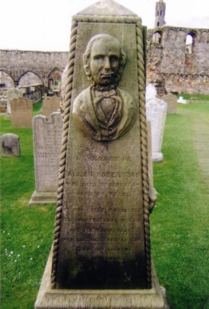 Alan Robertson's grave marker in the St. Andrews Cemetery .